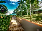 Walkway leading from the pool area to the Ranchero and guest house.