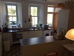 The large kitchen diner is fully equipped for self catering.