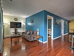 New hardwood flooring and serene blue-colored walls invite you into the modern home.