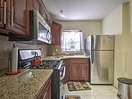With granite countertops and all of the necessary cookware, the kitchen is fully equipped with everything you'll need...