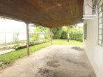Covered carport behind privacy gate