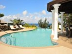 Outdoor infinity pool with ocean view, gazebo and picnic area