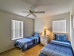 This bedroom's 2 twin beds are perfect for siblings or close friends.