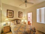 Rest up for a fun-filled day to come in this lovely bedroom's queen bed.