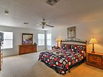 This spacious master bedroom boasts a plush king-sized bed.