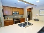 Galley Style Kitchen With Corian Counters