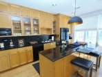 Kitchen Has Breakfast Bar with 2 Stools