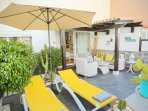 The Chill out right next to the massive pool entrance with your own sunbeds, music, beers, umbrella.