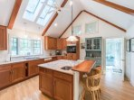 Kitchen with Center Prep Island opens to Sun Porch.