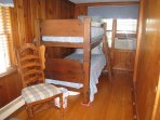 Other end of pine bedroom with bunk beds.