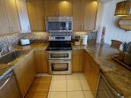 Beautiful kitchen, includes double oven, under counter beverage fridge, built-in recycling station,
