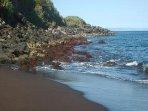 Black sand beach steps away