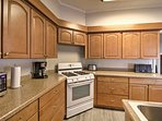 The fully equipped kitchen features updated appliances and ample counter space.