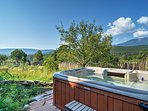 This 3,500-square-foot home boasts breathtaking views, a private hot tub and comfortable accommodations for 12 guests.