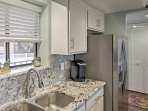 The fully equipped kitchen makes preparing home-cooked meals a breeze.