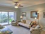Kick off your flip flops and relax on the cozy couch or swivel chairs.