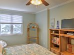 Relax in the privacy of the master bedroom as you enjoy a show on the flat-screen cable SmartTV.