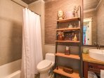 The bunk room ensuite bathroom has a tub-shower combo.