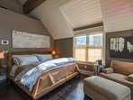 Take a load off in the master bedroom's king bed.