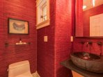 Step into the main level powder room for a quick touch-up.