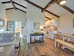 Lounge under beautiful wood beam ceilings throughout the upstairs area.