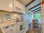 You will love the white granite countertops in the kitchen.