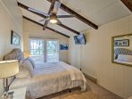 The master bedroom is located on the top floor of the house and has a cozy king-sized bed.