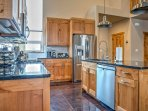 The kitchen is fully equipped with stainless steel appliances so you can cook with ease.
