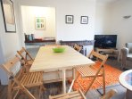 There is a fold away dining table with seating for six in the living room