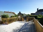 There is a large sunny decked and paved garden to the rear of the house with outdoor seating