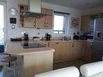 Kitchen includes induction hob, dishwasher, washer/drier + Nespresso coffee machine