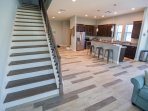 LUNA: open floor plan with breakfast bar and dining table. Granite counters & stainless steel app.
