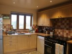 Kitchen -  cooker with double oven, dishwasher, fridge-freezer and second freezer in pantry.