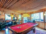 Game room with pool table.