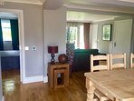 Open plan sitting room, dinning area and kitchen, fully wheelchair accessible.
