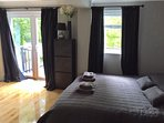 Bedroom from different angle to show french doors to decking area.