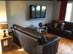 Sitting-room with sofa bed and flat screen TV... French doors to the pond/private garden.