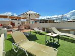 Sunbeds with unbrella at roof terrace