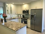 All new stainless appliances, Dishwasher is under the island.