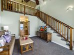 Ohana sitting area showcasing stairs to the loft style bedroom