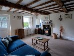 Exposed beams, wooden shutters to windows and log burner, Views to garden and far reaching panorama.