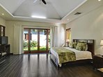 Master bedroom with garden and pool access