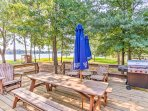 Lounge outside on the spacious wooden deck and enjoy the lakefront views!