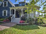 Beautiful landscaping painted with vibrant hydrangeas surrounds this traditional style home.