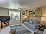 The living room is equipped with a 48-inch flat-screen cable TV.