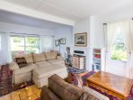 Unwind in the sitting room, complete with a couch and 2 armchairs.