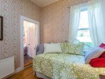 The cozy main floor bedroom has a twin daybed with a twin trundle.