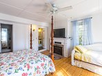 The master bedroom offers a flat-screen cable TV & wood-burning fireplace.