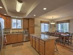 Prepare delicious home-cooked meals in the open, fully equipped kitchen.