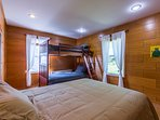 The Wood Walls Room has a queen bed and twin-over-twin bunk bed.
